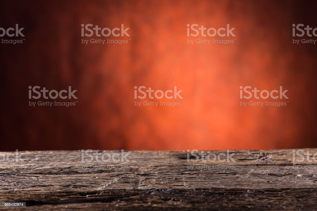 Empty wooden oak table and abstract red orange background.Free space for your product or information'n stock photo
