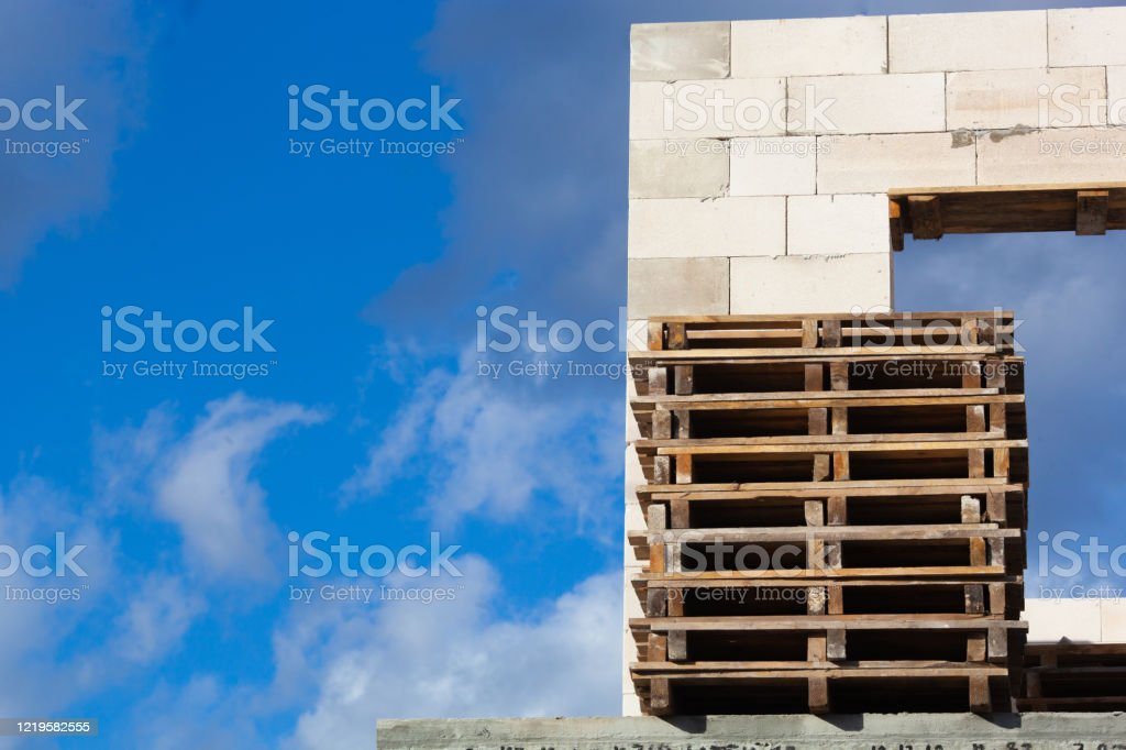 Empty Wooden Pallets Near The New Gray House Stock Photo ...