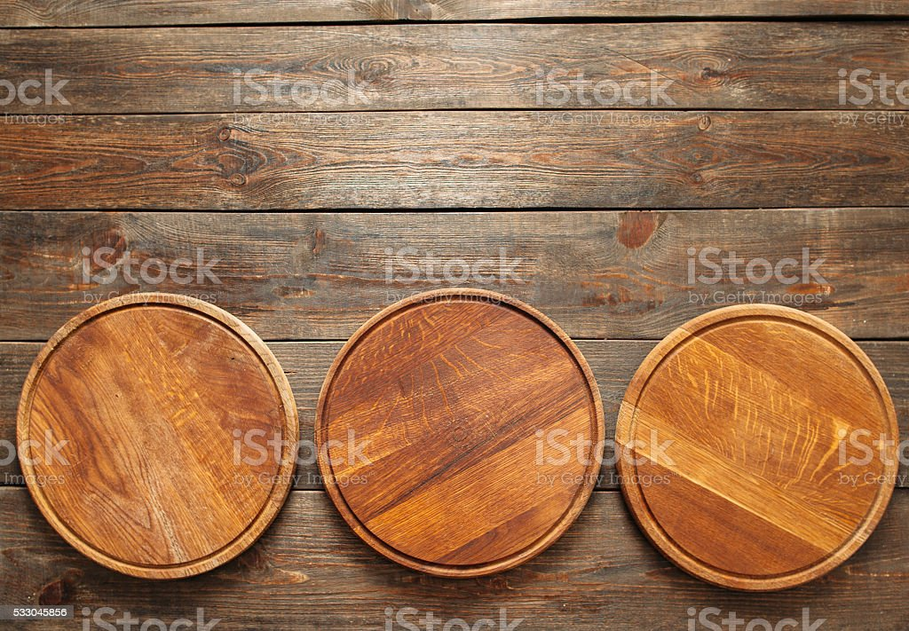 Empty wooden pizza plates with copy space stock photo