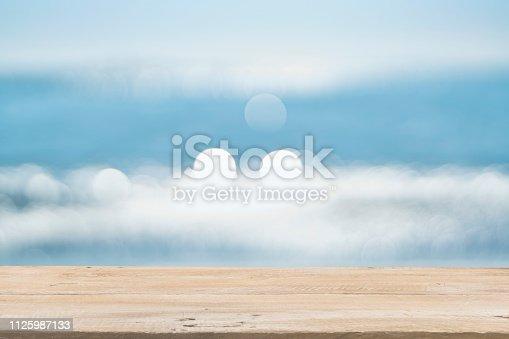 1125987088istockphoto Empty Wooden Planks with Blur Beach on Background 1125987133