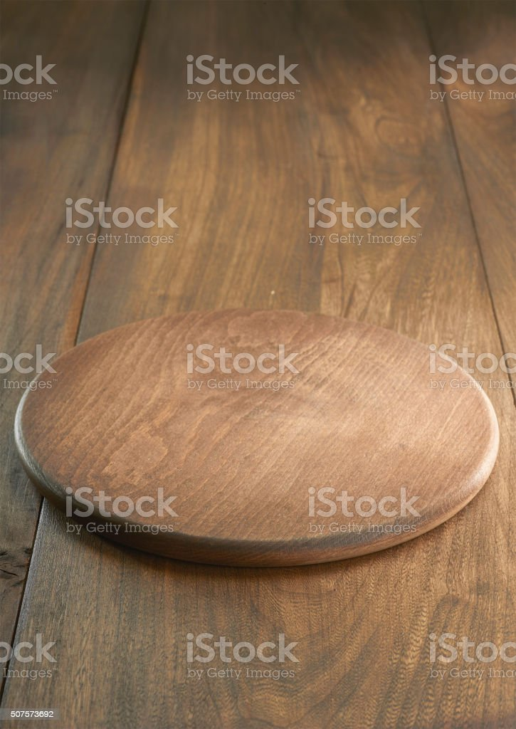 Empty wooden plate on wooden background stock photo