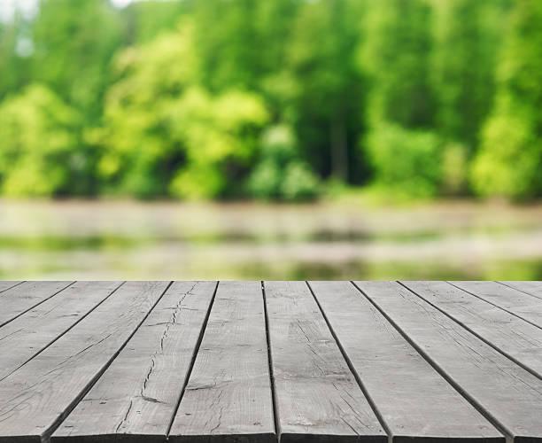 empty wooden platform and green nature abstract background - flod vatten brygga bildbanksfoton och bilder