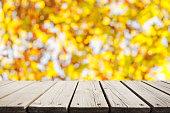 istock Empty wooden platform with beautiful autumn background 1180108320