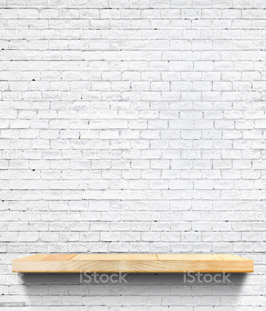 Empty Wooden shelf at white tile ceramic wall stock photo