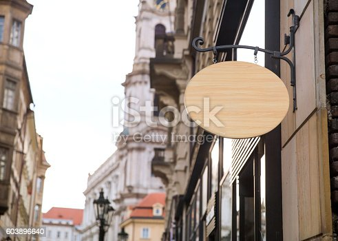 1128981457 istock photo Empty wooden signboard on a european street. Architectural detail 603896640
