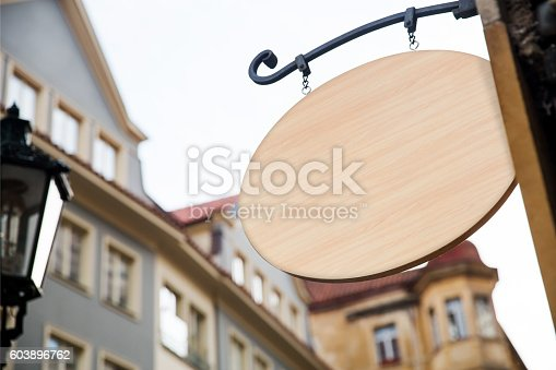 1128981457 istock photo Empty wooden signboard on a european street. Architectural detail 603896762