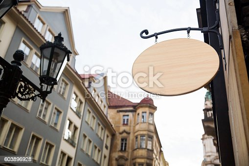 1128981457 istock photo Empty wooden signboard on a european street. Architectural detail 603896928