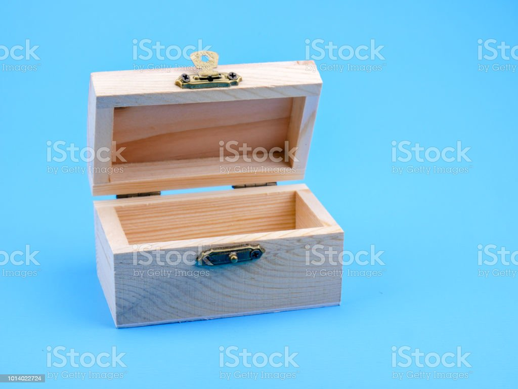 Empty wooden square box on blue background
