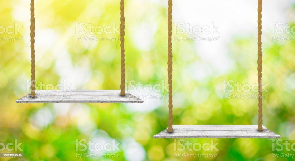 Empty wooden swing stock photo