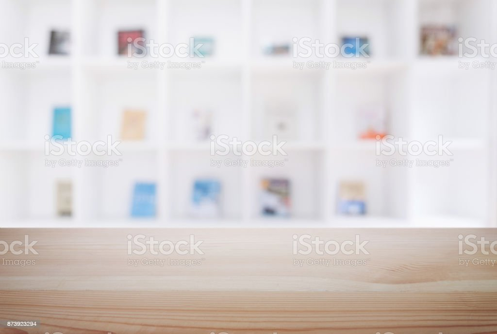 Empty wooden table and blur background of abstract in front of modern library or knowledge source can be used Mock up for display of product or for montage stock photo