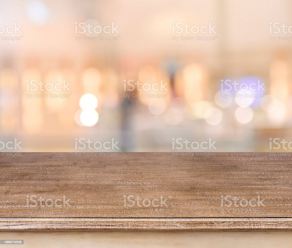 Empty wooden table and blurred abstract background stock photo