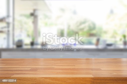 istock Empty wooden table and blurred kitchen background 489153314
