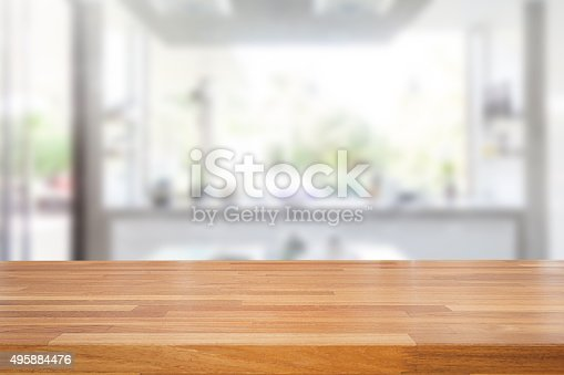 istock Empty wooden table and blurred kitchen background 495884476