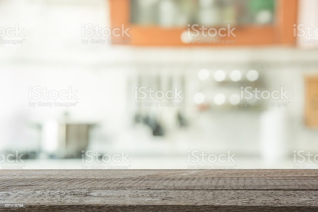 Empty wooden table and blurred kitchen background. stock photo