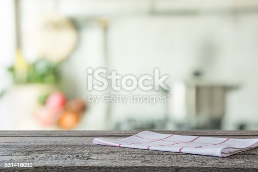 istock Empty wooden table and blurred kitchen background. 531416032