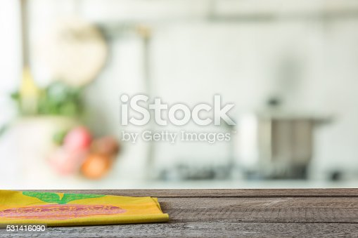 607472268 istock photo Empty wooden table and blurred kitchen background. 531416090