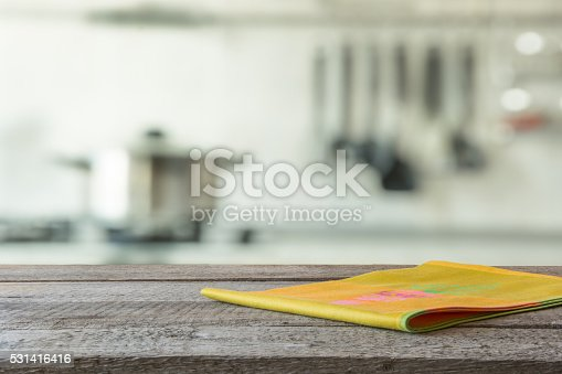 607472268 istock photo Empty wooden table and blurred kitchen background. 531416416