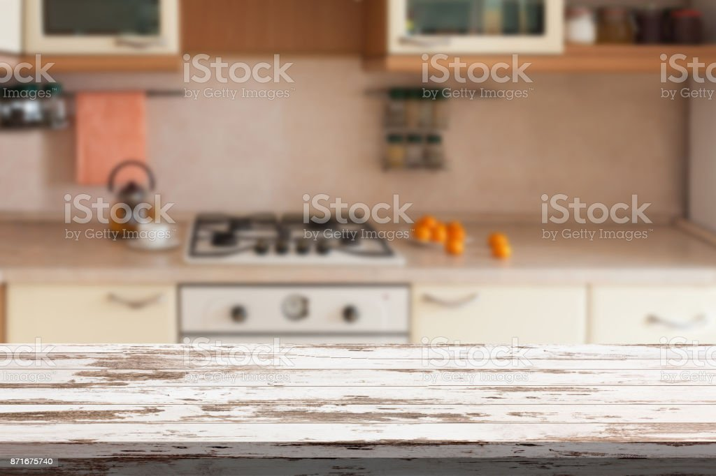 Empty wooden table and blurred kitchen background, product montage...