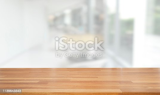 istock Empty wooden table and blurred modern white abstract background, Ready for product montage, indoor and window 1139643343