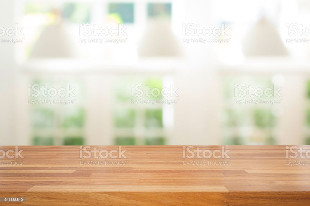Empty wooden table and modern  background with green ourdoor view stock photo