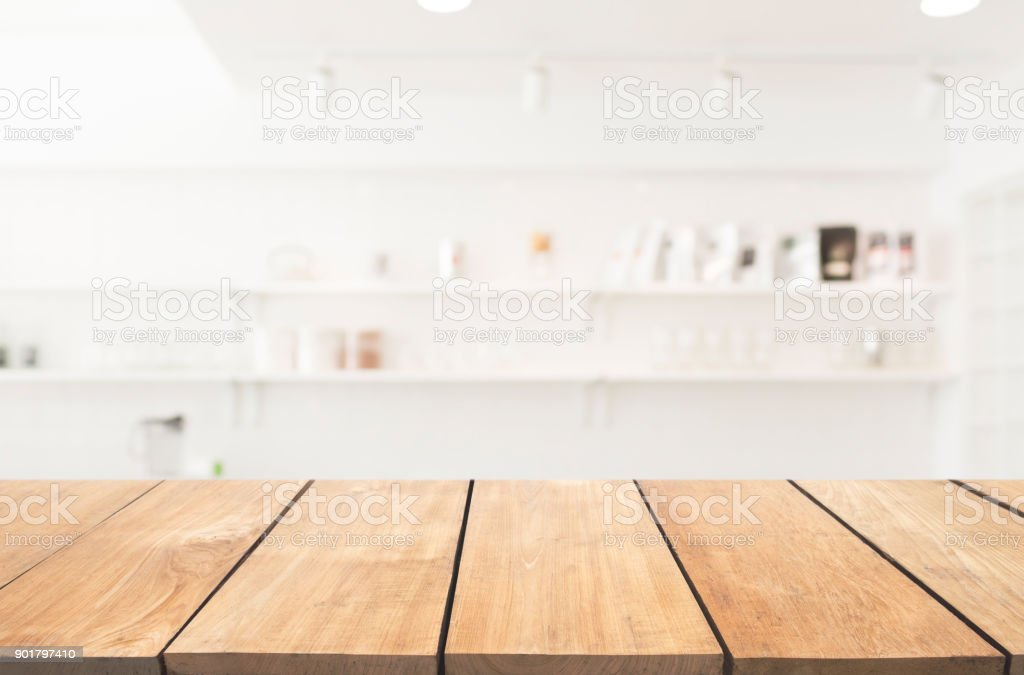Empty wooden table and modern kitchen background stock photo