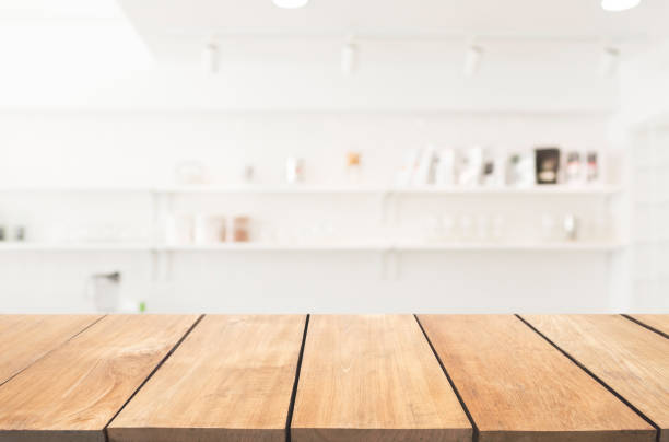 empty wooden table and modern kitchen background - kitchen counter imagens e fotografias de stock