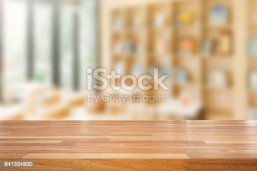 istock Empty wooden table and modern library background 641334930