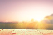 istock empty wooden table and sunrise nature background 1197994078
