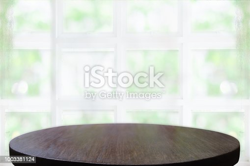 1002094650istockphoto Empty wooden table and window room interior decoration background, product montage display,can be used for display or montage your products.Mock up for display of product. 1003381124