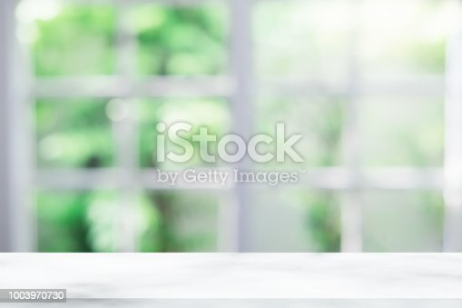 1002094650istockphoto Empty wooden table and window room interior decoration background, product montage display,can be used for display or montage your products.Mock up for display of product. 1003970730