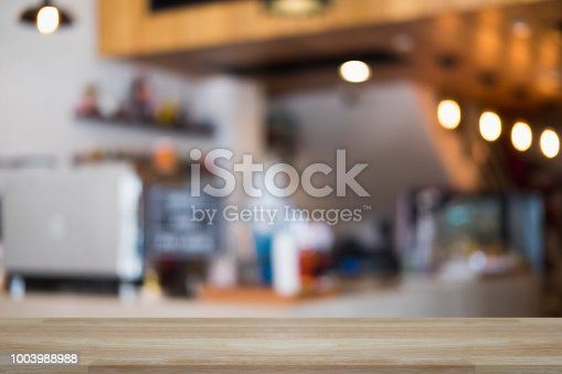 1002094650istockphoto Empty wooden table and window room interior decoration background, product montage display,can be used for display or montage your products.Mock up for display of product. 1003988988