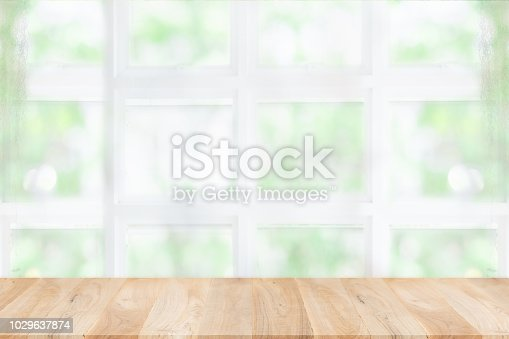 1002094650istockphoto Empty wooden table and window room interior decoration background, product montage display,can be used for display or montage your products.Mock up for display of product. 1029637874