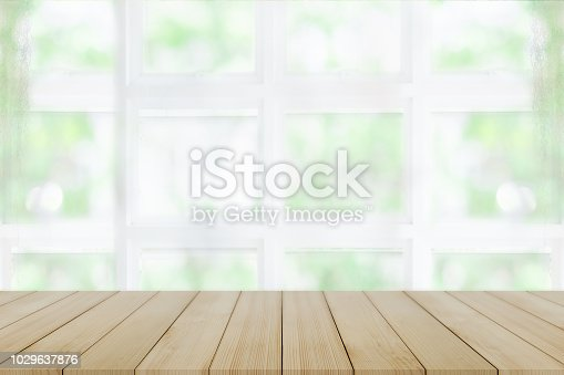1002094650istockphoto Empty wooden table and window room interior decoration background, product montage display,can be used for display or montage your products.Mock up for display of product. 1029637876