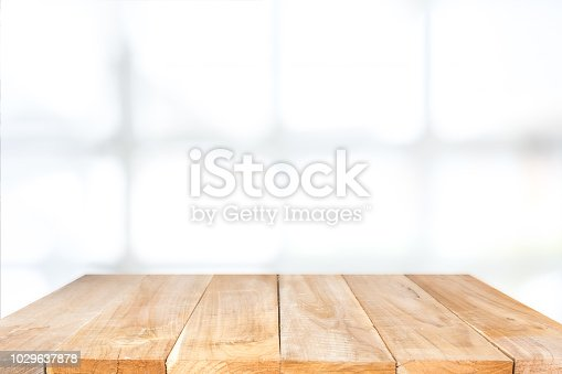 1002094650istockphoto Empty wooden table and window room interior decoration background, product montage display,can be used for display or montage your products.Mock up for display of product. 1029637878