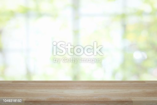 1002094650istockphoto Empty wooden table and window room interior decoration background, product montage display,can be used for display or montage your products.Mock up for display of product. 1049318152