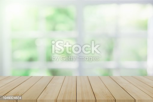 1002094650istockphoto Empty wooden table and window room interior decoration background, product montage display,can be used for display or montage your products.Mock up for display of product. 1049324524