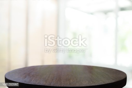 1002094650istockphoto Empty wooden table and window room interior decoration background, product montage display,can be used for display or montage your products.Mock up for display of product. 1051202052