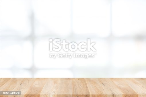 1002094650istockphoto Empty wooden table and window room interior decoration background, product montage display,can be used for display or montage your products.Mock up for display of product. 1051243686