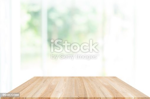 1002094650istockphoto Empty wooden table and window room interior decoration background, product montage display,can be used for display or montage your products.Mock up for display of product. 994820388