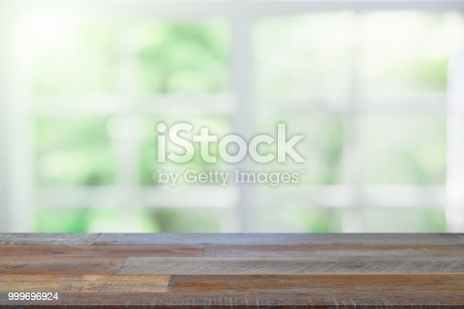 1002094650istockphoto Empty wooden table and window room interior decoration background, product montage display,can be used for display or montage your products.Mock up for display of product. 999696924