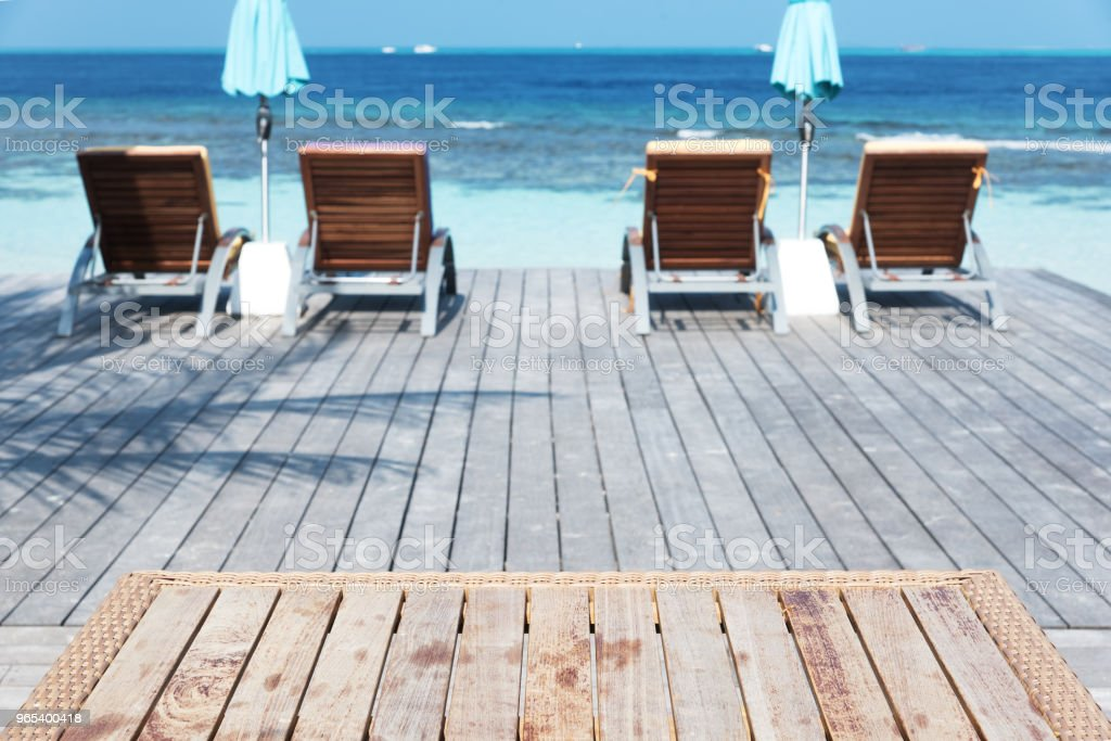 Empty Wooden Table Beside Sea View Terrace royalty-free stock photo