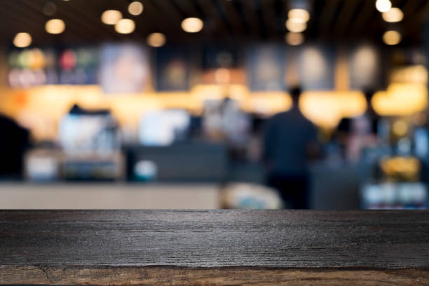 Empty wooden table for present product on coffee shop - foto stock