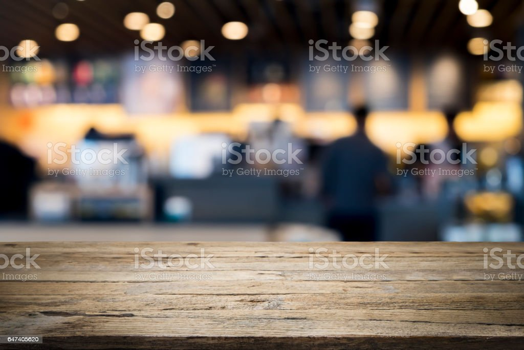 Empty wooden table for present product on coffee shop stock photo
