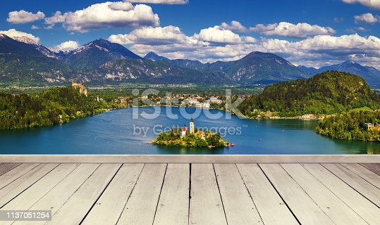 989111446istockphoto Empty wooden table for product placement or montage with focus to table top in the foregrounEmpty wooden table for product placement or montage with focus to table top in the foreground. Mock up for display of product. Beautiful background with forest, wa 1137051254