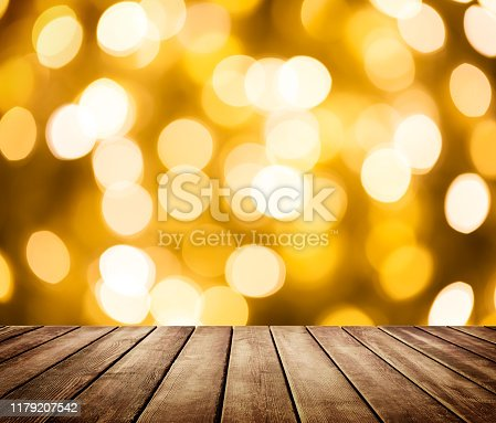 924418708 istock photo Empty wooden table in front of abstract blurred background 1179207542