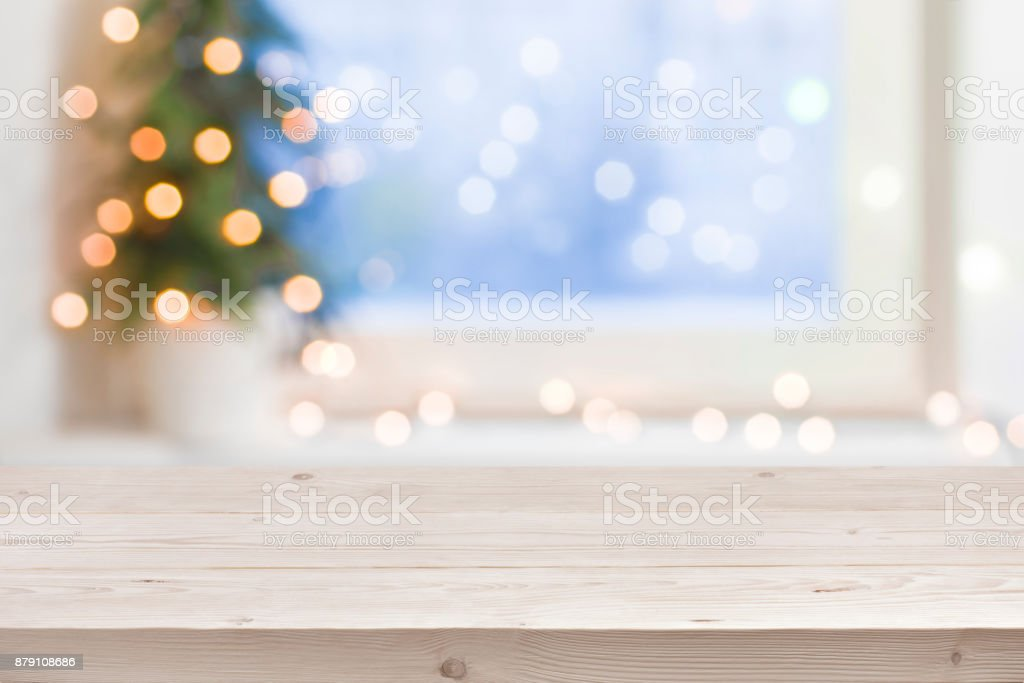 Empty wooden table in front of blurred winter holiday background stock photo