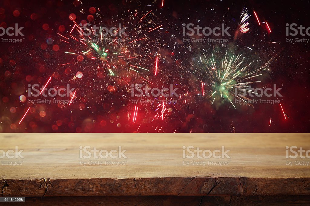 Empty wooden table in front of fireworks background stock photo