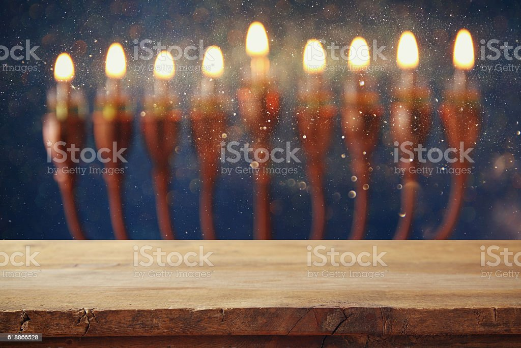 Empty wooden table in front of jewish holiday Hanukkah background...
