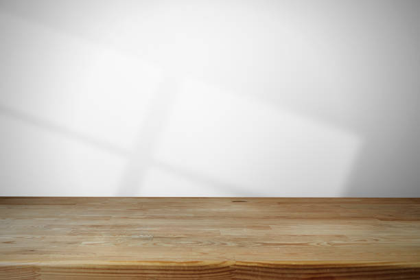 Empty wooden table in front of wall background stock photo stock photo