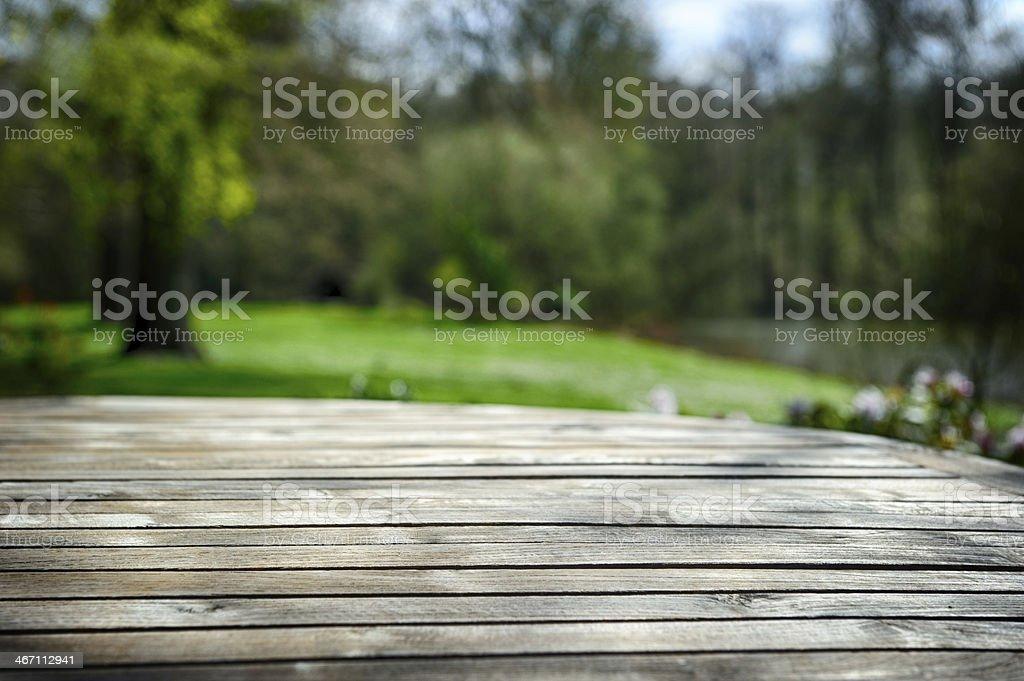 Empty wooden table in spring garden stock photo